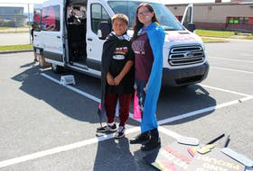 Eleven-year-old Allan Syllibo, left, and 16-year-old Jadis Paul wait for the start of the annual Pride parade in Eskasoni on Sept. 22 part of the fourth annual Kepmitelsi Eskasoni Pride week wrapped.