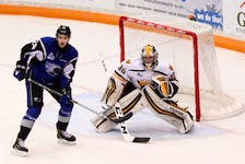 Screaming Eagles goalie Kyle Jessiman, shown here with the Sea Dogs' Cedric Paré perched on the doorstep, was the winning goalie in Cape Breton's road victory in Saint John on Sunday. The Eagles erased a three-goal, third-period deficit to force overtime during which Drake Batherson scored his third goal of the game to give Cape Breton a 6-5 win. (DAN CULBERSON/SAINT JOHN SEA DOGS)