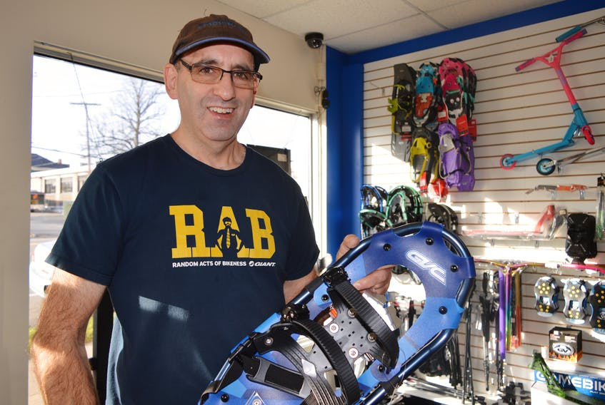 Bill Goldston, owner of FrameWork Cycle & Fitness on George Street in Sydney, holds one of the many lightweight snowshoes he has in stock. CHRIS SHANNON/CAPE BRETON POST