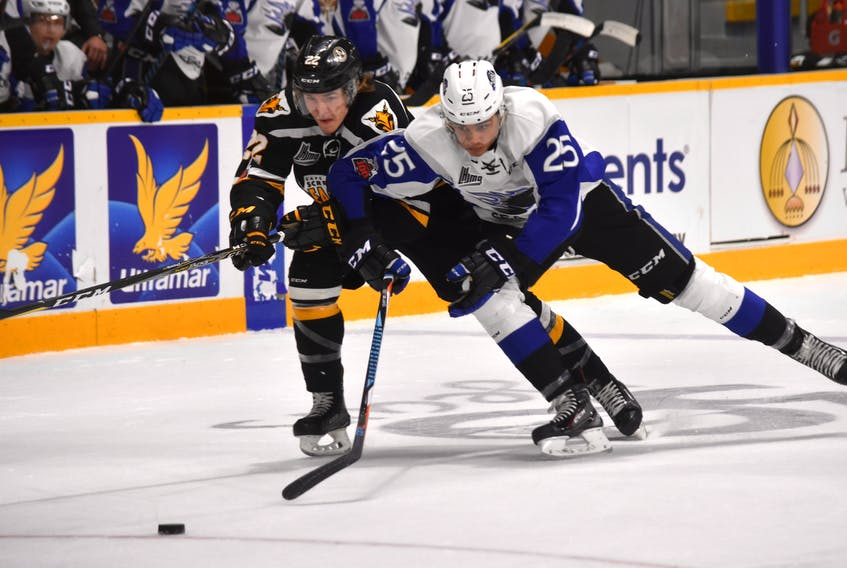 Jordan Ty Fournier of the Cape Breton Screaming Eagles, left, fights off Isiah Campbell of the Saint John Sea Dogs during the first period of Quebec Major Junior Hockey League action Wednesday at Centre 200. T.J. Colello/Cape Breton Post