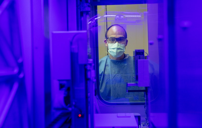Medical laboratory technologist Fred Li monitors the operation of the Cobas 6800 instrument used in COVID-19 tests at the microbiology laboratory at QEII Health Sciences Center in Halifax.  The lab can process 10,000 to 15,000 tests per day.  - Communications Nova Scotia