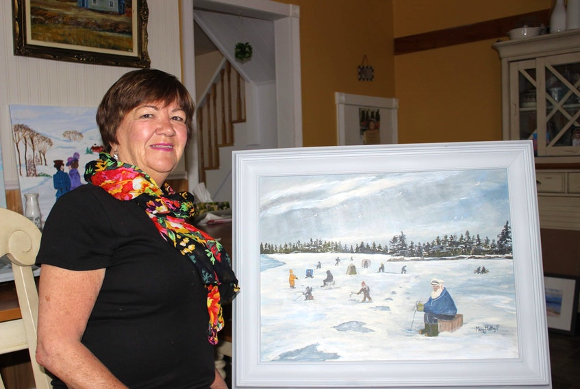 Mary Mullins, 72, stands beside one of her favourite paintings, which will be on display for her first solo art exhibit - Nostalgia. Taking place at the Main Street Gallery, inside the New Waterford Credit Union, the opening for the show is June 28 from 3 p.m. – 4:30 p.m.