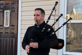 """Ryan MacNeil performed a rendition of """"Amazing Grace"""" on George Street in Sydney at 8 a.m. on Friday. He and bagpipers around the world were performing at that time to honour those who died in recent mass shootings in Nova Scotia."""