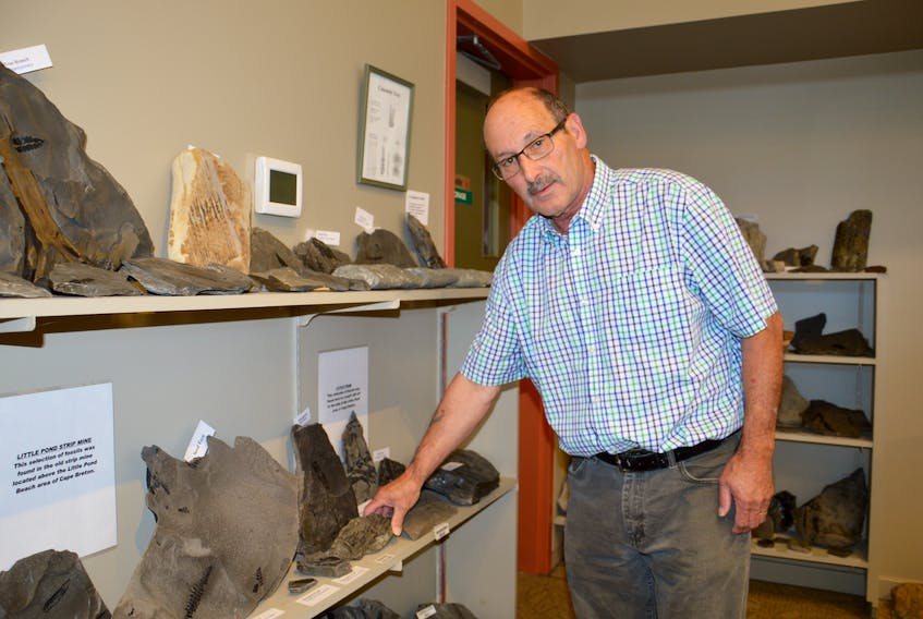 Stuart Critchley, curator for the Sydney Mines Heritage Society, shows fossils at the Cape Breton Fossil Centre in Sydney Mines. The Sydney Mines museums broke attendance records this year with more than 10,700 visitors attending the location. JEREMY FRASER/CAPE BRETON POST