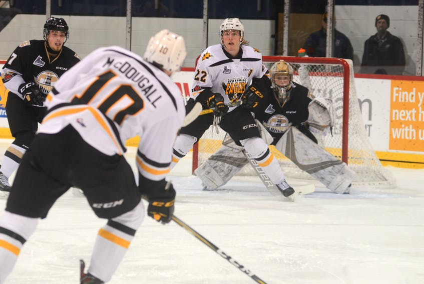 Jordan Ty Fournier of the Cape Breton Screaming Eagles stands in front of Matthew Welsh of the Charlottetown Islanders as Cape Breton's Ross McDougall prepares to take a shot on goal during Quebec Major Junior Hockey League action at the Eastlink Centre in Charlottetown, Friday. The Islanders won the game 5-3.