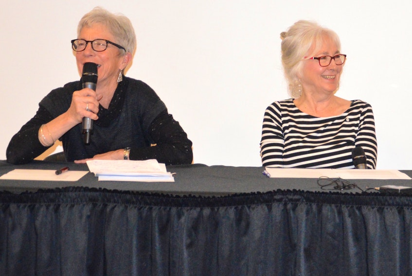 From left, Rhoda MacCormick and Joella Foulds share a laugh during an information session on medically assisted death Thursday. The two were friends of the late Weldon Bona.