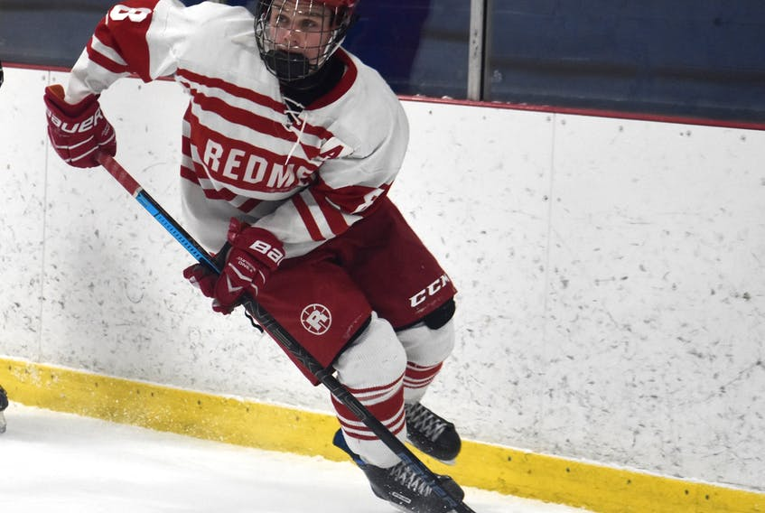 Blake Cox of the Riverview Redmen carries the puck during Cape Breton High School Hockey League action earlier this year. Cox was named the league's most valuable player on Wednesday.