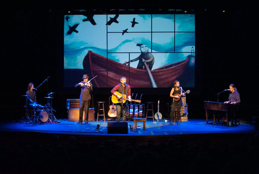 """Singer/songwriter Lennie Gallant and his band perform """"Searching for Abegweit."""" The group is now on tour and will appear this evening in Port Hawkesbury. Shown here, left to right are, Jonathan Gallant on drums, Sean Kemp on violin, Lennie Gallant on guitar, Patricia Richard on mandolin, and Jeremy Gallant on keyboards. Submitted photo"""