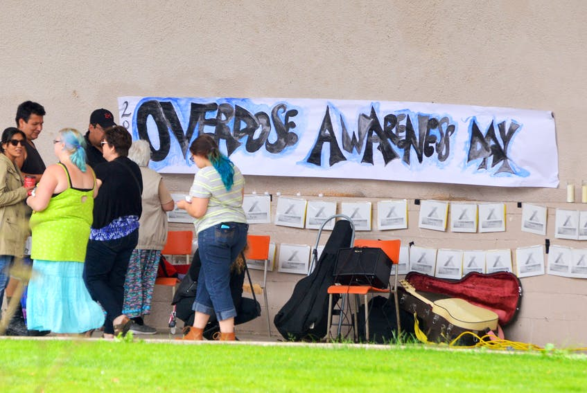 People gather in the bandshell before the start of Overdose Awareness Day in Sydney in August 2017.