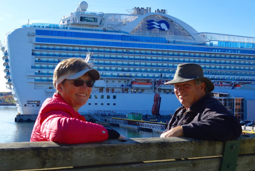 Mary and Mike Marcy enjoy a last few moments in Sydney prior to their departure on the 3,000-passenger Crown Princess. The Marcys, of London, Ont., were among more than 5,000 people from two ships to visit Cape Breton on the final day of the 2017 cruise ship season.