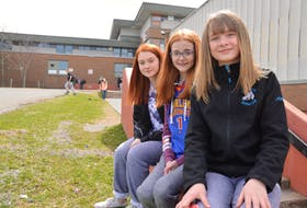 Grade 7 students of Breton Education Centre in New Waterford, from left, Taylor Wilson, Courtney Kelly and Jorja McPhee, relax in front of the school. The girls all were all happy to hear the news of major renovations slated for BEC. The Department of Education announced 13 projects of new builds or major renovations to schools across in the province over the next five years.