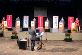 The six candidates vying to be the next mayor of the CBRM took part in a two-hour forum on Wednesday evening at the Membertou Trade and Convention Centre. The event was hosted by the CBC and moderated by Information Morning host Steve Sutherland, shown in the foreground. On stage from left are candidates Amanda McDougall, Archie MacKinnon, Chris Abbass, John Strasser, Cecil Clarke and Kevin MacEachern. DAVID JALA/CAPE BRETON POST