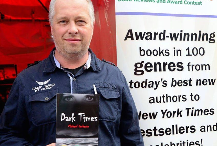"""Michael Gerhartz with his 2019 Readers' Favourite Honourable Mention for Best Thriller for his second novel, """"Dark Times"""" at the Miami International Book Show."""