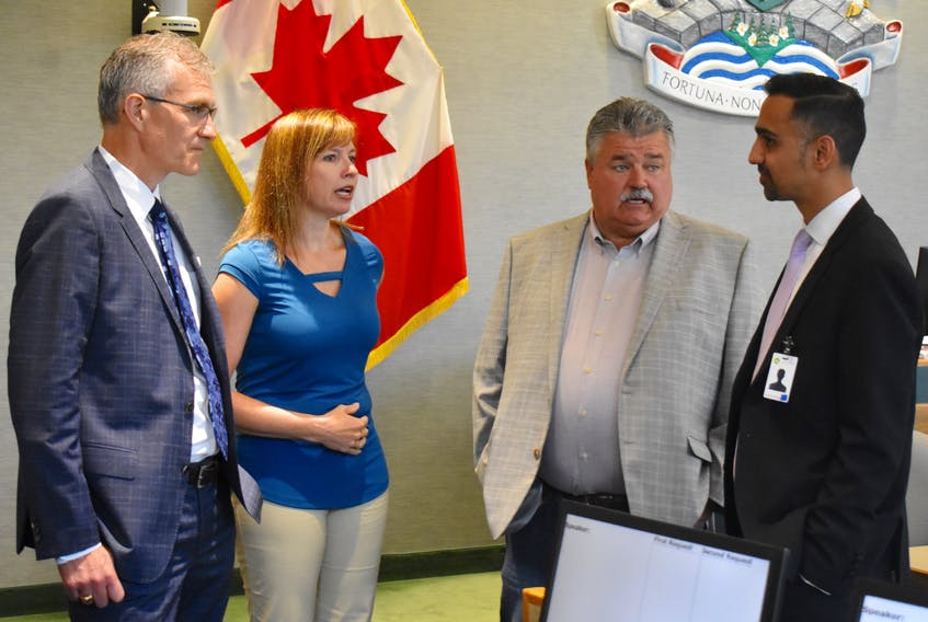Grant Thornton accounting firm representatives John MacNeil, left, and Ricky Soni, far right, chat with CBRM chief financial officer Jennifer Campbell and CBRM councillor and chair of the viability study steering committee Darren Bruckschwaiger, prior to their presentation of the final report of a study on the future viability of the cash-strapped municipality. Local officials say the report confirmed what they already knew, that being that the municipality is fast heading down the road toward financial ruin and is essentially unsustainable under present conditions.