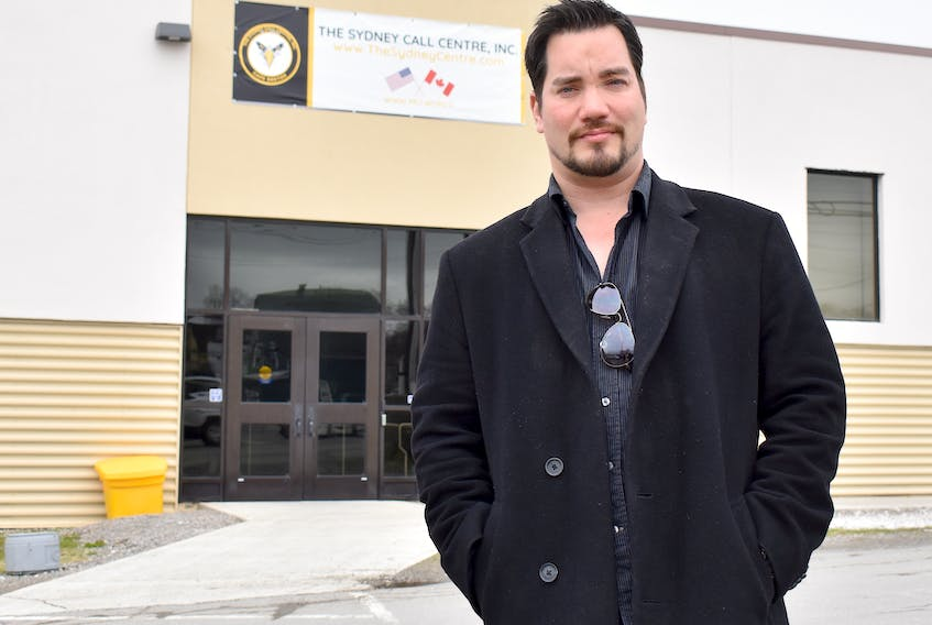 Chris Feltrin stands outside the Sydney Call Centre on Wednesday. Feltrin and his former ServiCom co-workers can now apply to Service Canada's wage earner protection program to recover some of their unpaid wages, bonuses, severance pay and vacation entitlements.
