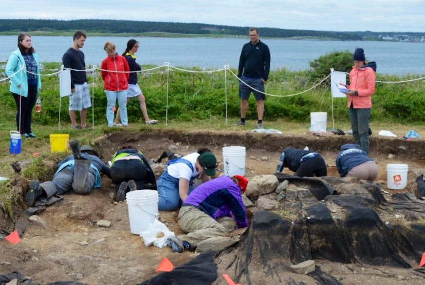 Bioarchaeologist students from the University of New Brunswick are seen excavating a burial site at Rochefort Point at the Fortress of Louisbourg on Friday. The university and Parks Canada have partnered to save the site from coastal erosion and better understand life in Louisbourg in the 1700s.