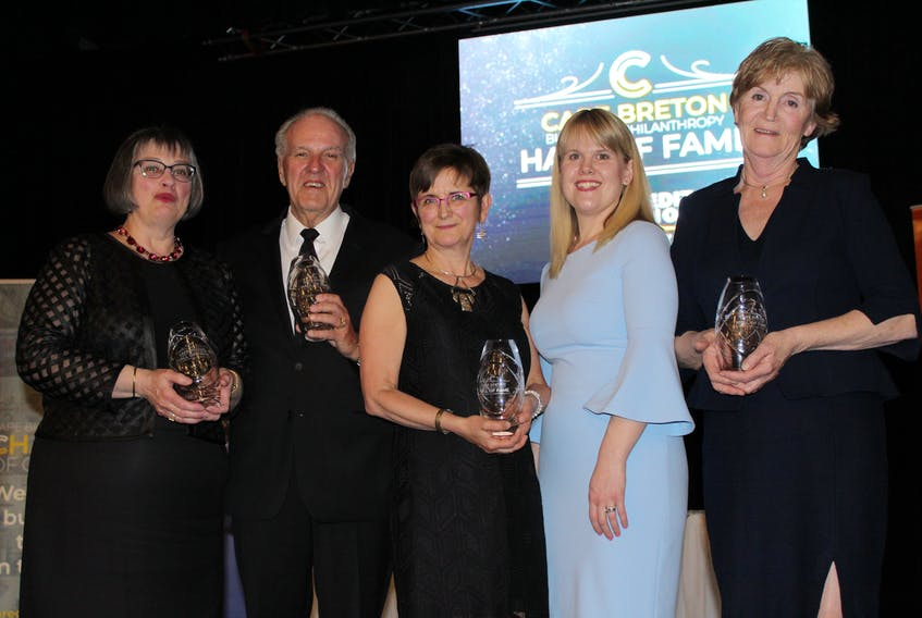 The business community turned out Wednesday evening to celebrate the newest inductees into the Cape Breton Business and Philanthropy Hall of Fame at the Membertou Trade and Convention Centre. Those inducted were, from left, Sheila Gillis of MGM and Associates, Sydney businessman Bill Mozvik in the business category; Jeannie Eyking represented her late mother, Jeanne Eyking, and Bethany Eyking stood in for her grandfather, John Eyking, who could not attend Wednesday's ceremony where they were inducted into the philanthropy category; and Lori Kennedy, who, along with husband Jim Kennedy, were honoured in the business category for their 35 years of work at Louisbourg Seafoods Ltd.