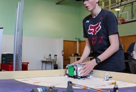 Angus Campbell, 15, of Sydney, works with a Lego robot at the Brilliant Labs workshop at the Nova Scotia Power Makerspace in Sydney. Campbell wants to encourage his peers to try out the tech activities the space has to offer, especially with summer camps starting in July.