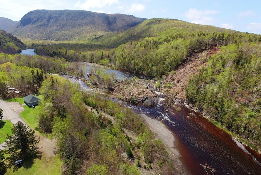 """A 10-day cleanup along the shore of the Chéticamp River in May 2018 helped prevent a near disaster as Atlantic salmon returning to the river to spawn were blocked from reaching their destination after a landslide. For its efforts, Parks Canada was awarded the Atlantic Salmon Federation's highest award, the T.B. """"Happy"""" Fraser award for salmon conservation."""