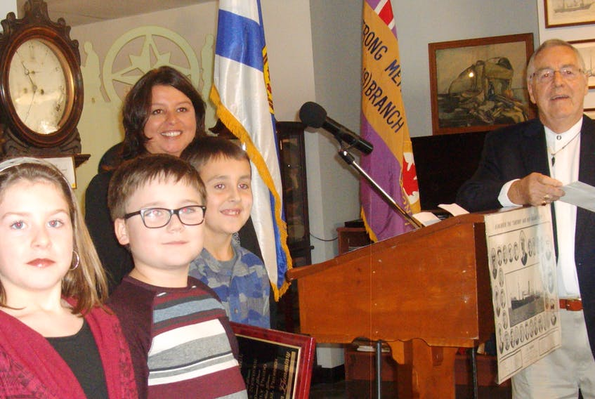 SUBMITTED PHOTO Three students from Seton Elementary School, Max Newhook, Emily Predo and Michael Prosser were presented with awards by District 2 councillor Earlene MacMullin and society member Gordon Sampson. Absent from the photo are Fallon Lawrence, Trevor Thomas and Sophia Capstick from Ferrisview Elementary School.