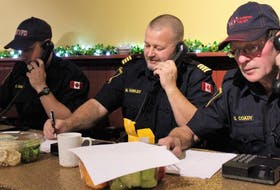 Christopher Coady, Matt Hawley and Gerald Coady are shown volunteering their time for annual Combined Christmas Giving Telethon and Auction.