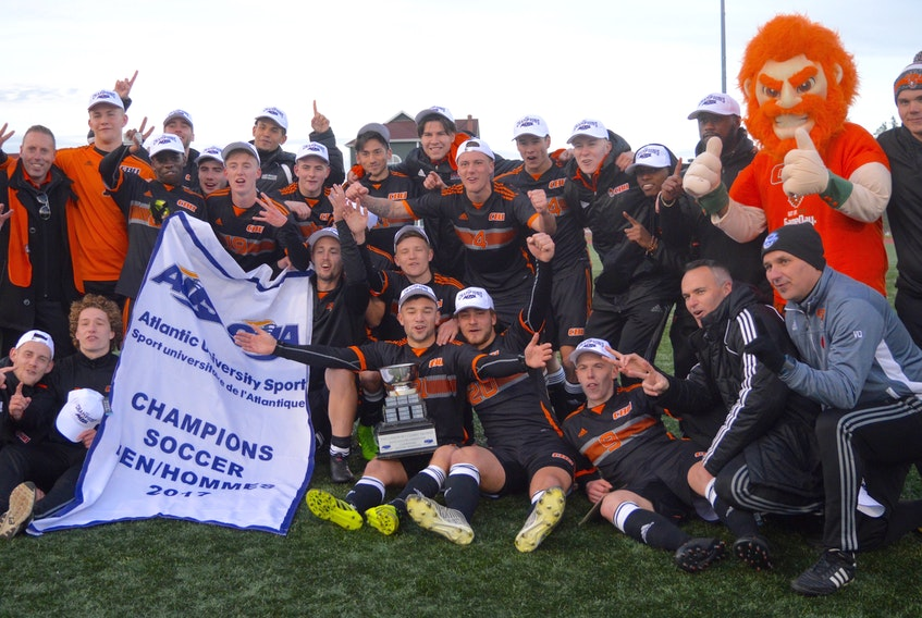 DAVID JALA/CAPE BRETON POST - Players, coaches and mascot gather for an impromptu pictures minutes after the Cape Breton Capers won the  Atlantic University Sports men's soccer championship.