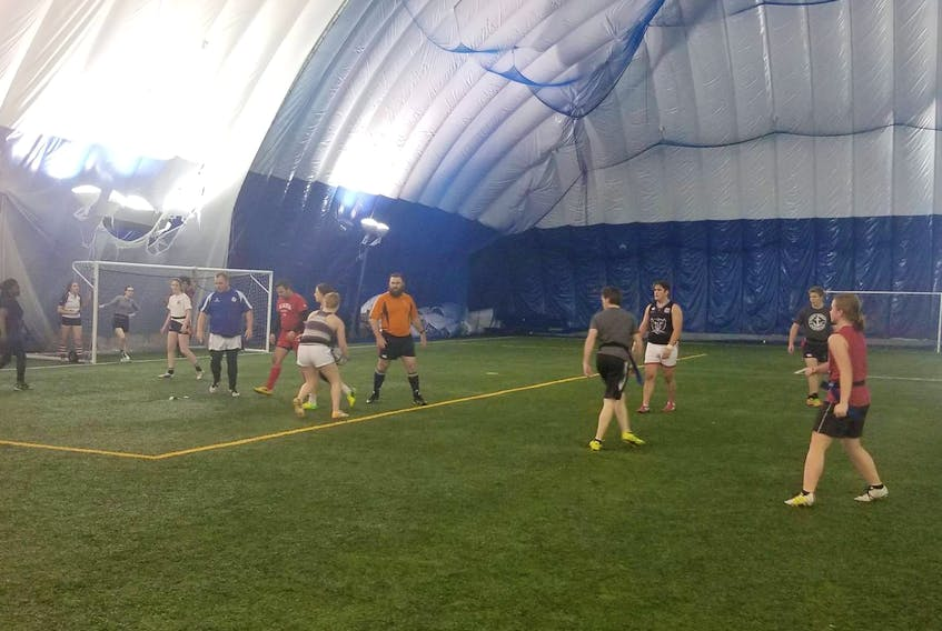 Local rugby players are shown participating in a game of flag rugby recently at the Cape Breton Health Recreation Complex Dome. Submitted photo.