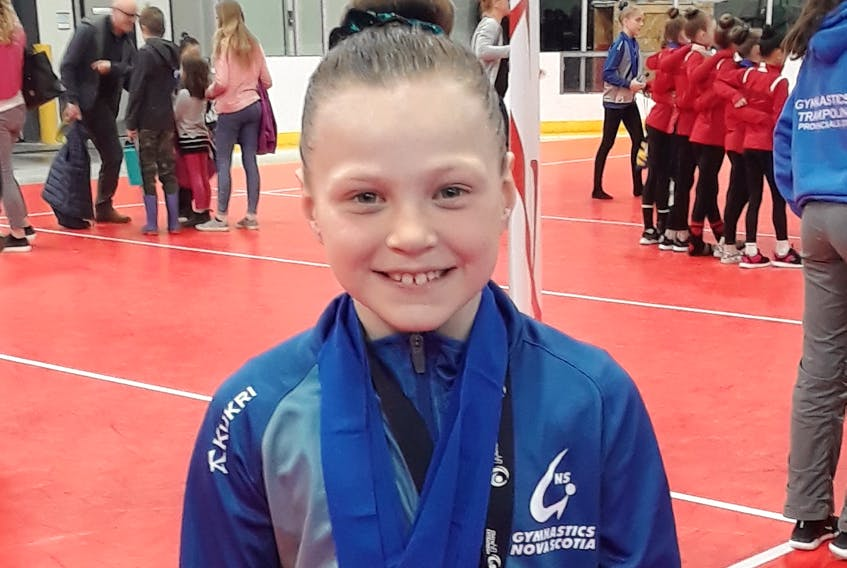 Charley Sawlor of Sydney captured the bronze medal in the Argo 5 division of the Atlantic Gymnastics Championships last month in Fredericton. Sawlor was the youngest Cape Breton gymnast to compete for Nova Scotia at the event. As for the Argo team, the Nova Scotia group placed first at the tournament. SUBMITTED PHOTO/KERRI SAWLOR