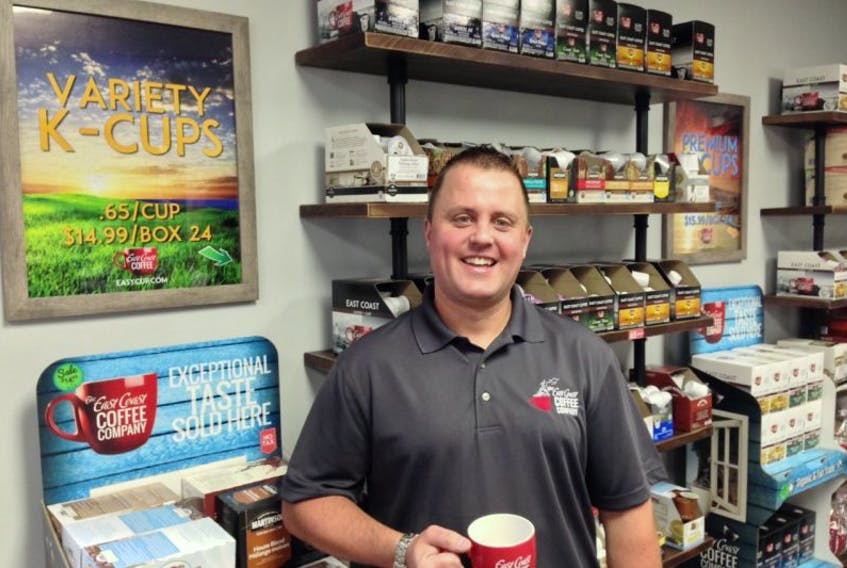 Dave MacKinnon, owner, stands inside the new East Coast Coffee retail shop in North Sydney. You can buy K-cups, whole beans, ground beans and the company's signature big red coffee mug.