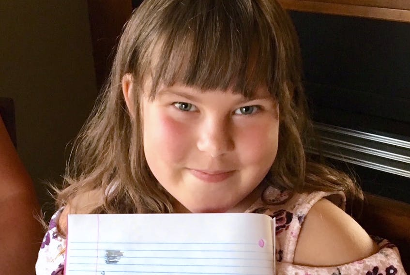 Lexie Stagg, 8, proudly displays her handwriting, which she learned from her mother at home. Newfoundland and Labrador is one of three provinces in which cursive writing is not mandatory in the school curriculum.