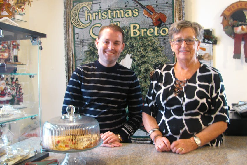 SUBMITTED PHOTO - Glad Tidings celebrates 25 years in business, with new owner Dillon Carter, left, and former owner Marion MacLeod Stone.