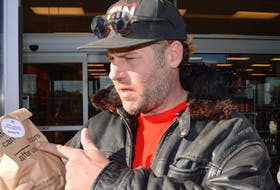 Ashley MacIsaac is seen outside NSLC story in Sydney River this morning after purchasing cannabis on the first day of legal sales in Canada.