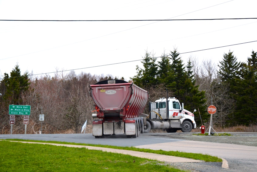 A Donkin coal truck turns from Long Beach Road in Port Morien onto Highway 255 towards Dearn's Corner. Port Morien residents say the roads aren't wide enough for these trucks and they have difficulty making this turn.