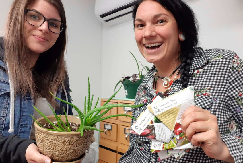 St. Peter's Library assistant Ashley Dempsey, left, and Tara Paon of the Community Skill Exchange-Richmond County TimeBank are preparing to open Richmond County's community seed exchange on Saturday at the St. Peter's Library.