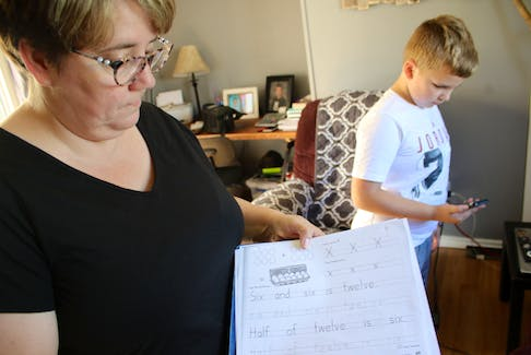 Darlene and Tyler Whalen at their home in Sydney Mines. Frustrated with a long wait list for psychological assessment through the school system, they paid for a private assessment.