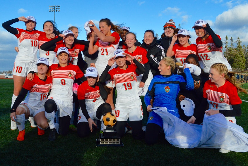 "The Cape Breton Capers celebrated their second consecutive AUS women's soccer championship after defeating the rival St. Francis Xavier X-Women 1-0 in the title game Sunday at the CBU field. The Capers played the first half with a very strong wind at their backs in a game that CBU veteran defender Becky Hanna described as ""the hardest game I've ever played."" The Capers are one of eight teams that will participate in the national championship tournament that kicks off Thursday in Ottawa."
