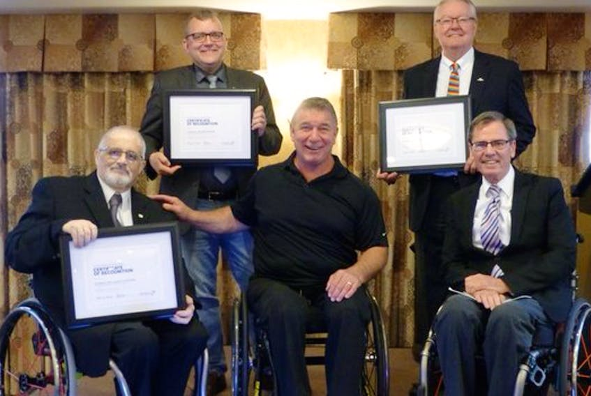 Rick Hansen, front row centre, presented the Rick Hansen Difference Maker Award to the Municipality of the County of Inverness in Truro recently. Shown here left to right, front row, are Inverness Coun. Laurie Cranton, Hansen and Gerry Post, executive director of Nova Scotia's Accessibility Directorate. Back row, left to right, are Waye Mason, president of the Nova Scotia Federation of Municipalities and Halifax city councillor, and Wolfville Mayor Jeff Cantrell, who also accepted a Hansen award for his town's efforts in making Wolfville more accessible.