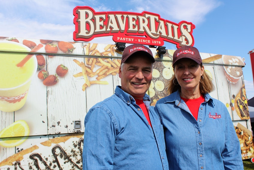 Bob and Karen Walker stand in front of their mobile BeaverTails trailer at Open Hearth Park in Sydney, Thursday. The pastry and poutine franchise is relatively new to the palate of Cape Bretoners. The Walkers recently purchased the rights to the franchise for all of Cape Breton Island.