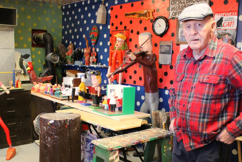 Murray Gallant, 80, stands in The Barn, his artist studio located in the backyard of his New Waterford home on Monday. Around him are some of the wooden sculptures the folk artist will have on exhibit at his solo show happening throughout the month of February as part of the New Waterford Library's Heritage Day initiative.