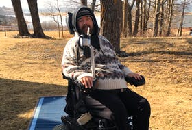 Callum MacQuarrie smiled from his wheelchair on top of some Mobi-Mats. The Inverness man is a member of the committee that is working towards making Inverness Beach fully accessible to wheelchairs and walkers.