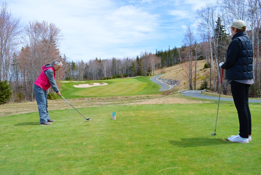 Debi Sullivan watches as Elizabeth Buffett of Sydney River takes her shot at No. 11 at The Lakes at Ben Eoin Golf Club and Resort on Tuesday. An injunction hearing began Thursday at the Nova Scotia Supreme Court in Sydney into the Cape Breton Ski Club's application to stop the transfer of the golf course to the Ben Eoin Development Group Inc.