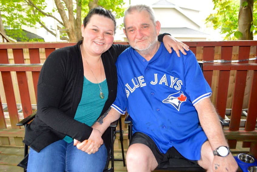 Glen McGean and daughter Natasha McGean are shown in this file photo. Glen, who has cancer, had a dying wish to see his favourite baseball team, the Toronto Blue Jays, in action one more time. Thanks to his daughter, his wish will be fulfilled after a fundraising campaign exceeded its goals in just four days.