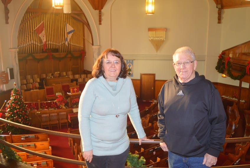 From left, Rita Johnston and Billy MacDonald stand on the balcony at the St. Andrew's Presbyterian Church in Sydney Mines. The church will host The Miners' First Noel concert on Dec. 29. All money raised from ticket sales will go to the church.