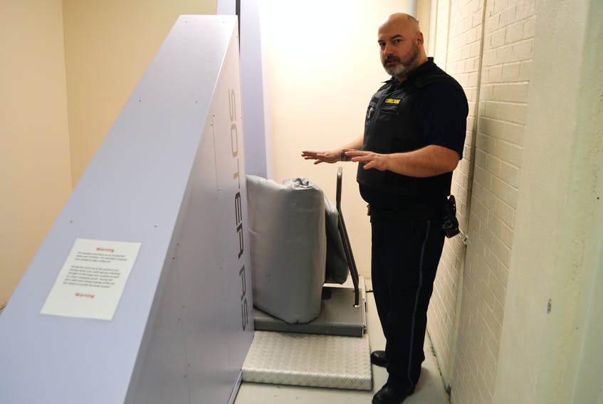 Jason Weldon, security risk officer at the Cape Breton Correctional Centre in Gardiner Mines, demonstrates the facility's new body scanner with a mattress. The ultimate goal of the body scanner — used for inmates as well as objects like mattresses, clothing and footwear — is to eliminate contraband being brought in the system and make strip searches less intrusive.