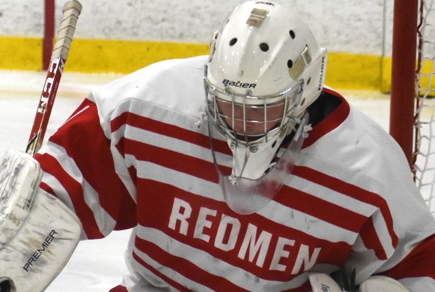 """Shown above in this file photo from last season is Riverview Redmen goaltender Michael MacMullen wearing the team's white and red jersey. The name """"Redmen"""" displayed on the front of the Riverview High School hockey jersey will soon be taken off and replaced with something new and different."""