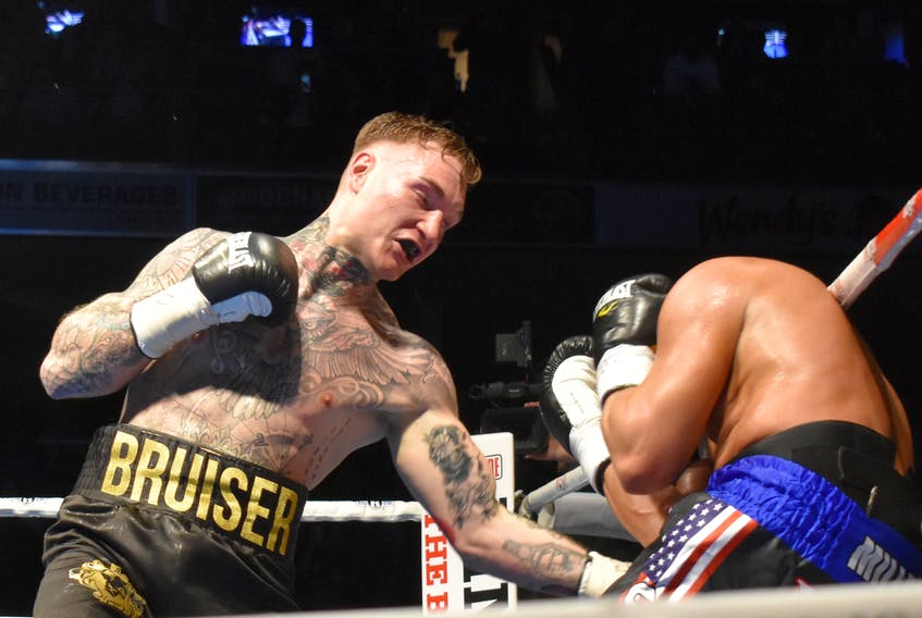 Ryan Rozicki, left, lands a left punch to the body of Shawn Miller during the All or Nothing main event, which saw the Sydney Forks boxer defeat Miller for the WBC International Silver cruiserweight championship at Centre 200 on Saturday.
