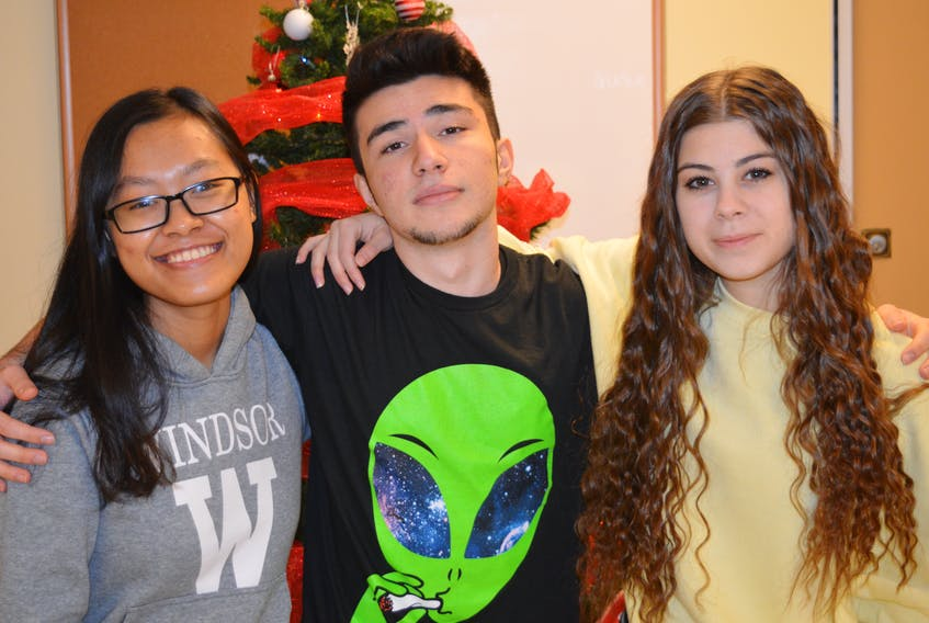 International students at Breton Education Centre in New Waterford Thy Lai, from left, Dogukan Dinler and Marta Mattioli are pictured above. The grade 12 students will be spending their Christmas break in Canada for the first time.