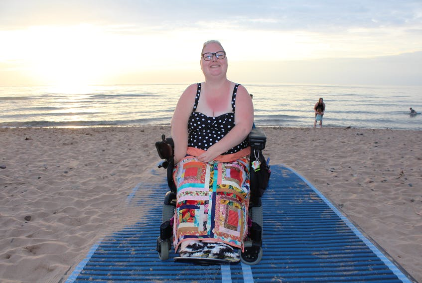 """Erin MacPhee was closer to the Atlantic Ocean on Tuesday than she's been in almost 20 years, thanks to a new ramp and special wheelchair-friendly mats that lead to the water's edge. """"Sitting here, hearing the waves hit the beach, this is home,"""" the 39-year-old Inverness native, who now lives in Halifax, told the Post."""
