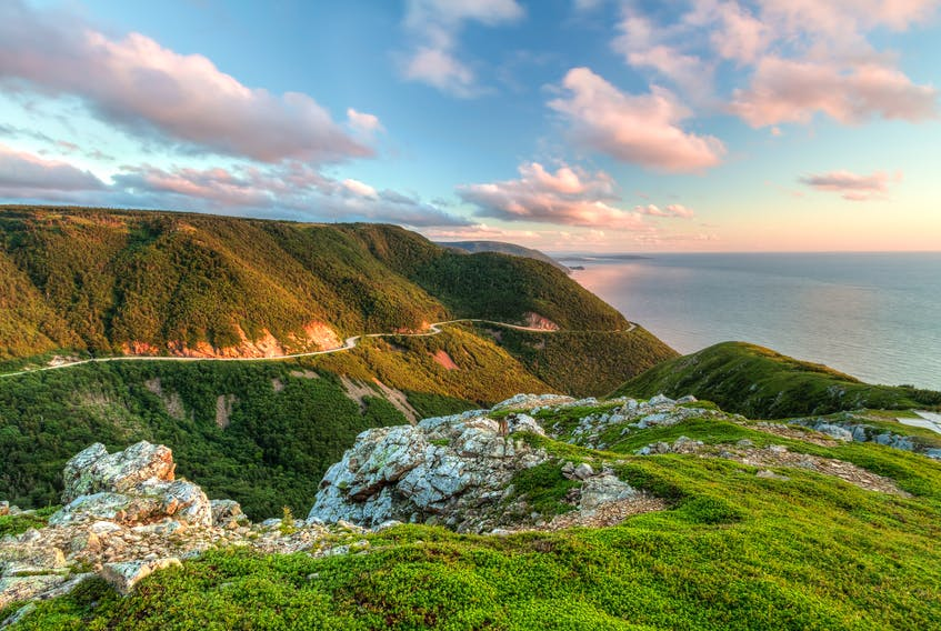 The Cabot Trail is seen from the Skyline Trail at sunset in Cape Breton Highlands National Park. Cape Breton tourism operators saw widespread declines in visitor traffic over the summer months after the record numbers set in 2017 from the year-long Canada 150 celebrations.