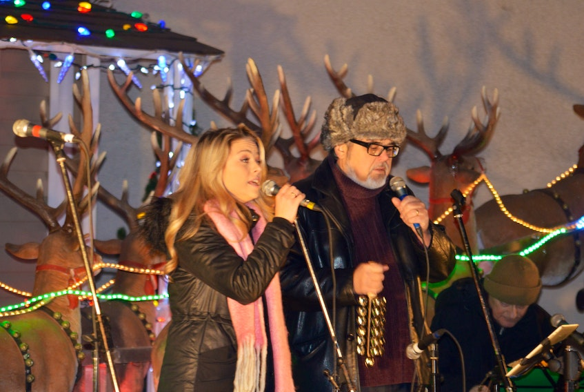 Samantha Gracie, left, is shown performing with her father John Gracie in Wentworth Park in December 2016. The Gracies annual Christmas concert returns to the park Saturday, Dec. 23 at 7 p.m.
